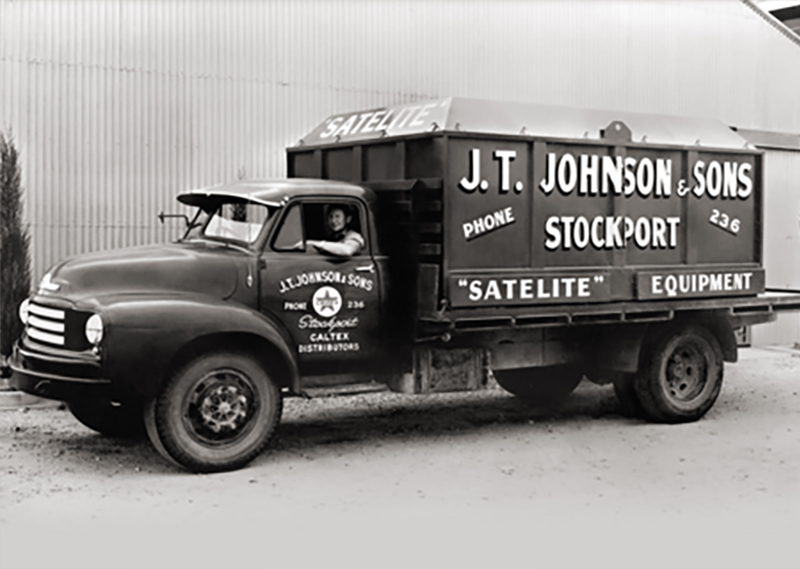 Clyde Johnson driving J.T. Johnsons & Sons truck circa. 1950's